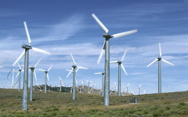 Techachapi-Mojave wind farm with more than 5,000 wind turpines. 1.3 mil kwh produced per year. Techachapi Mountains in California.
