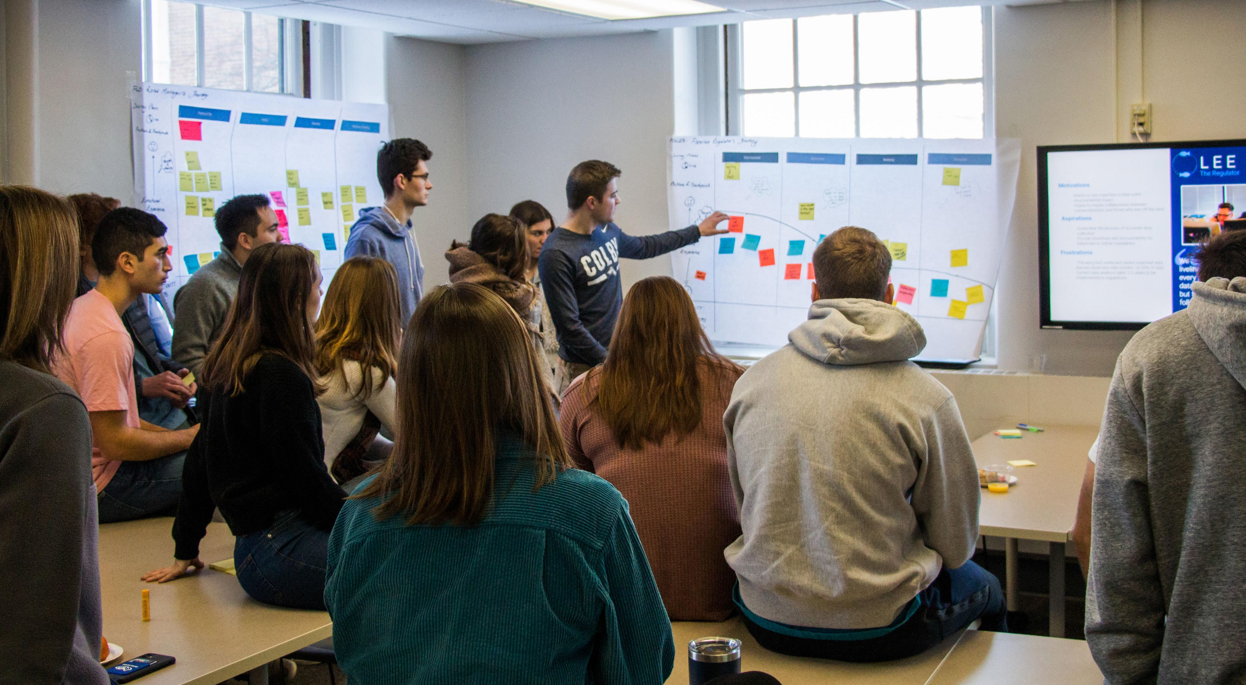 Colby College students work through an ideation and journey mapping session.