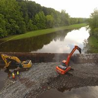Heavy equipment removes the Columbia Lake Dam on the Paulins Kill River.