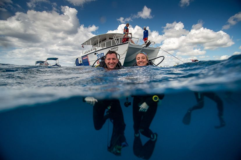 TNC staff members Joe Pollock and Ximena Escovar in the Caribbean Sea ready to dive and restore a coral reef.