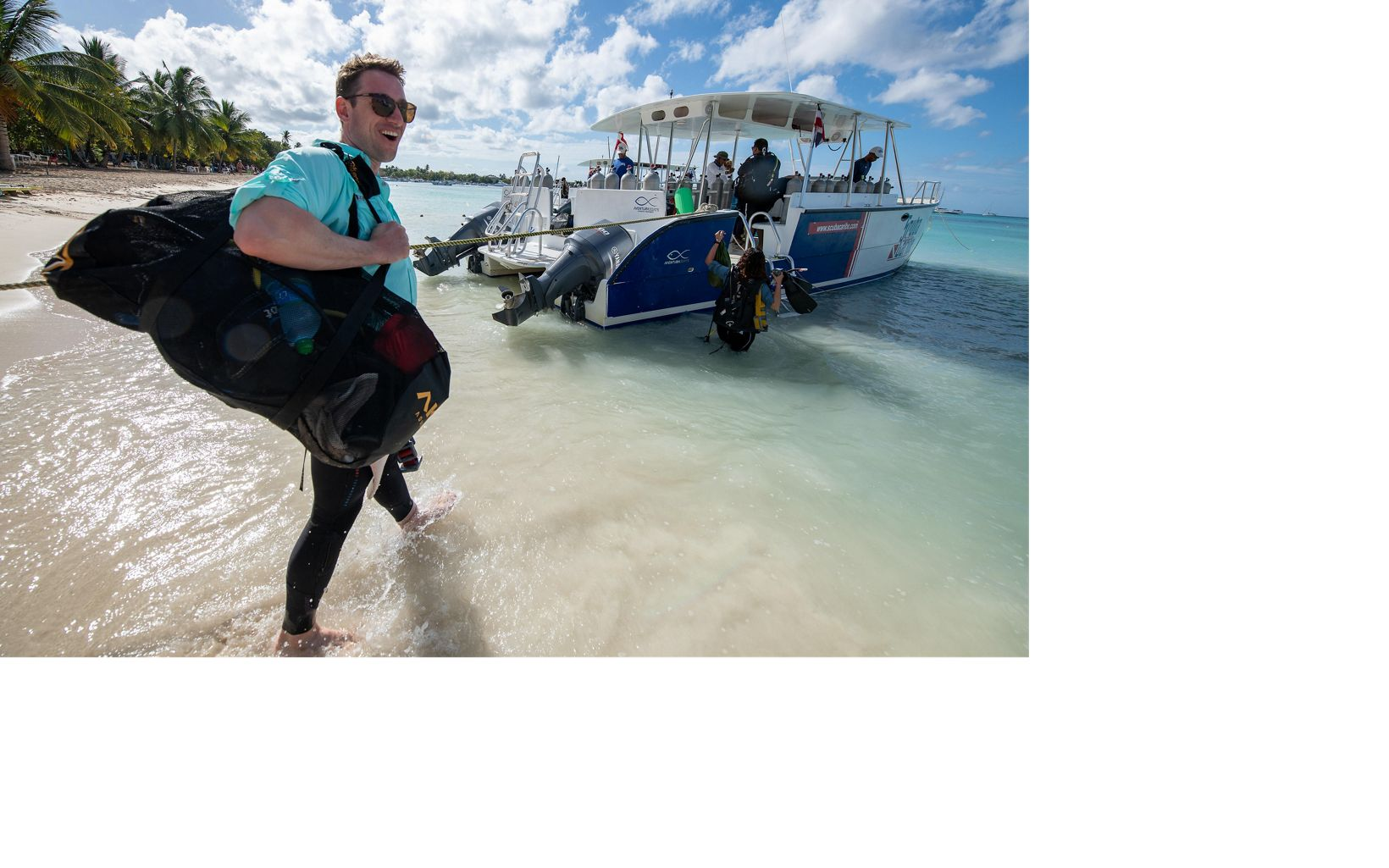 Joe Pollock, Coral Strategy Director, heads to the boat for a dive off the coast of the Dominican Republic.