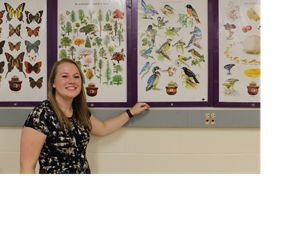 Teacher Corinne Grossmeier with nature posters