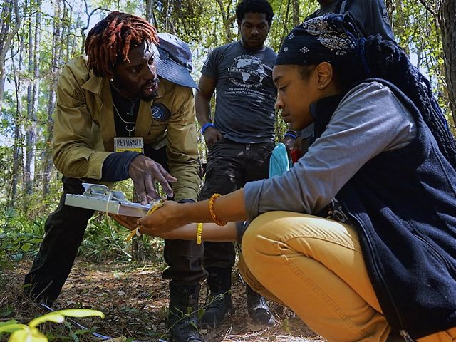crew leader Mikah-Hakim Lewis (L) assists crew members Zhian Hunt, Jasmine Poole (foreground) and Quentin Riley with monitoring sheets prior to the star