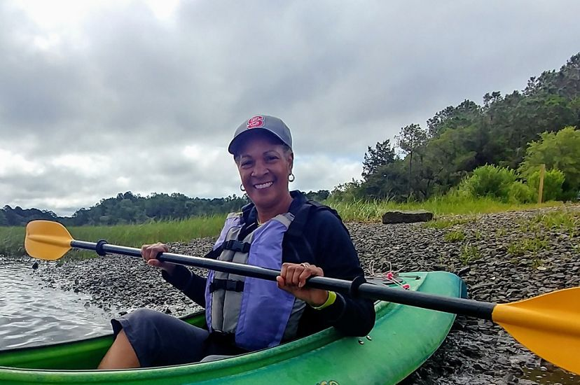 Dale Threatt-Taylor, State Director of TNC in South Carolina, in a kayak on the Wando River while preparing for a donor kayaking event.