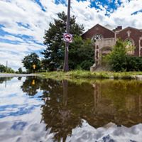 Flood waters surround a church.