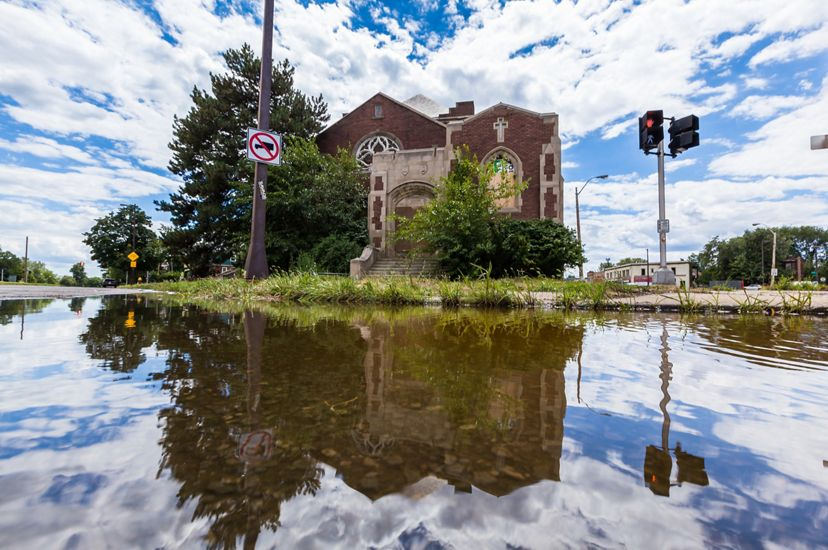 An intersection is flooded in front of an old building in Detroit.