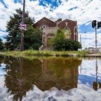 Stormwater flooding surrounds a church in Detroit, MI.