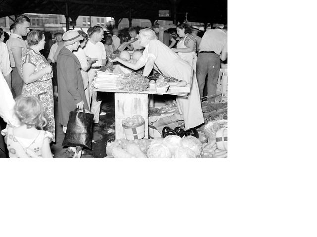 Shoppers select produce from vendors at Detroit's Eastern Market, August 14, 1937.