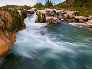 Rushing rapids over rocks.
