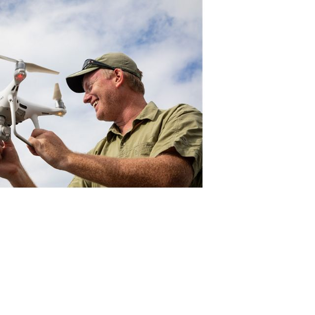 Dr. Steve Schill, Lead Scientist for TNC in the Caribbean, prepares a drone for launch. This will validate and verify the accuracy of the satellite and aerial mapping.