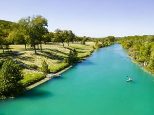 Kayaking along the Blanco River in Texas Hill Country.