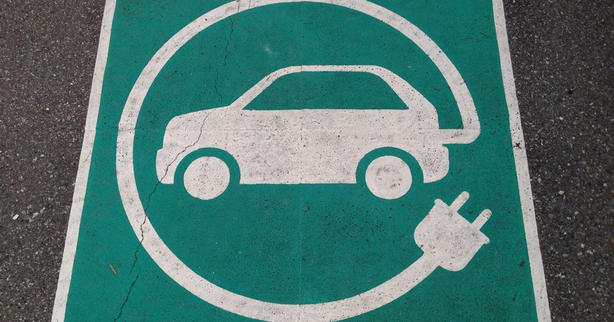 Pavement sign for an electric car charging spot