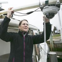 In partnership with The Nature Conservancy, IT Project Manager with MRAG Americas, Connie Delano, hooks up a video camera to monitor the daily fishing catch of the Dawn T at Saquatucket harbor in Harwich, Cape Cod