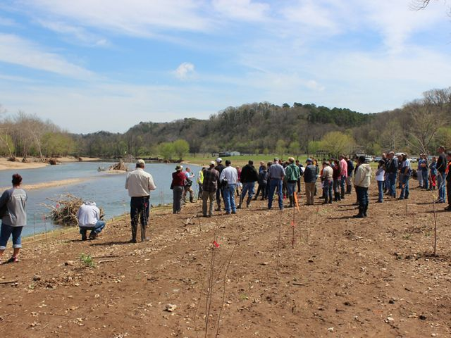 Partners visit to view a newly constructed streambank on the Elk River.