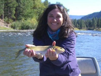 A woman holds a shad.