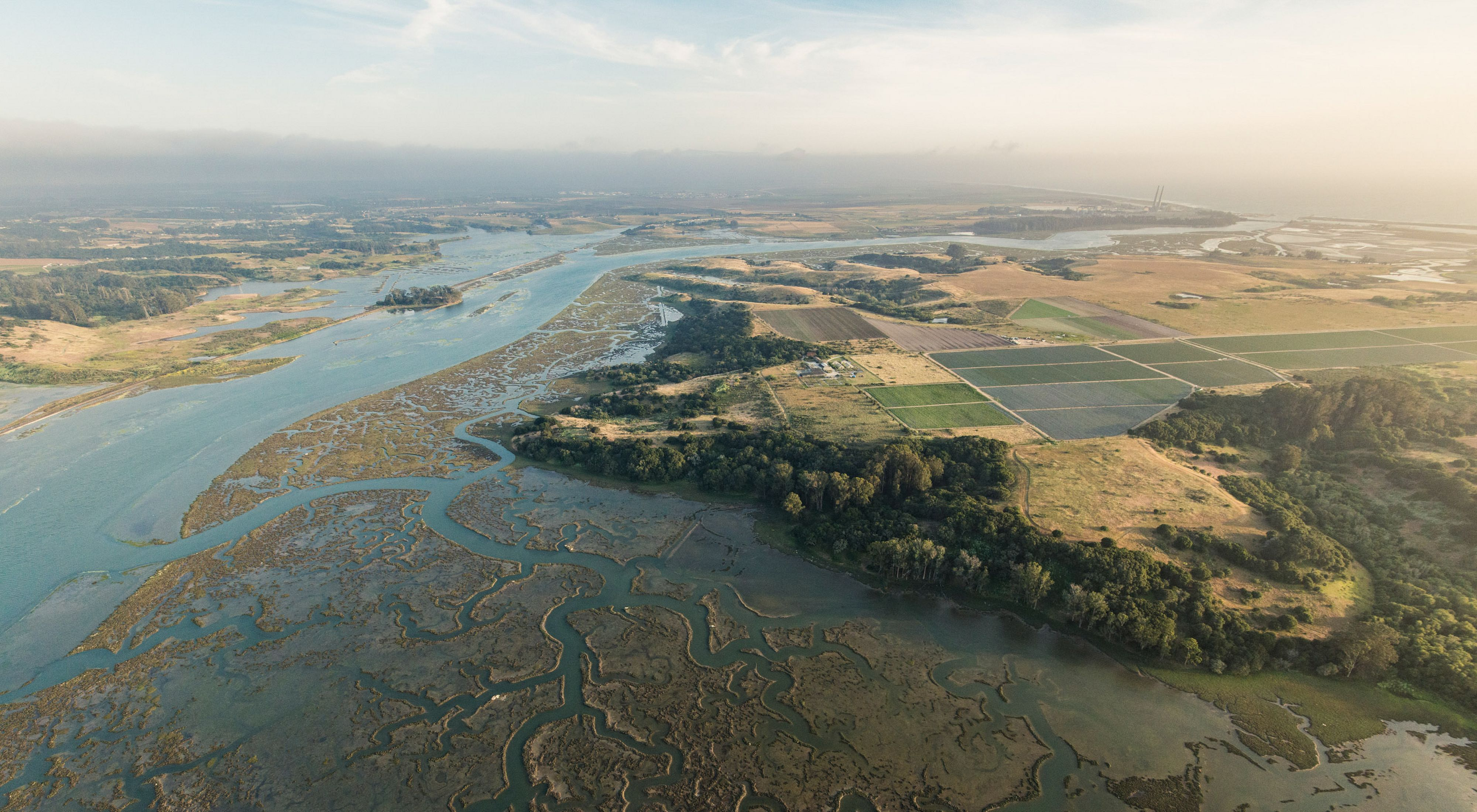 An aerial view of a California river and agricultural fields.