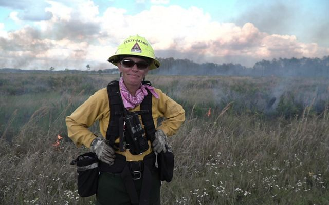 Cody-Marie Miller in fire gear at a controlled burn.