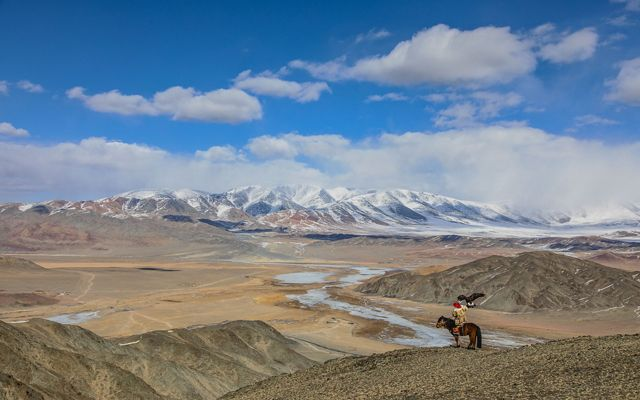 Mongolia's Altai Mountains (with Kazakh golden eagle hunter in the foreground)