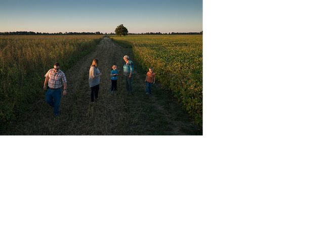 Judy Wilson and her family walk through their Kentucky farm