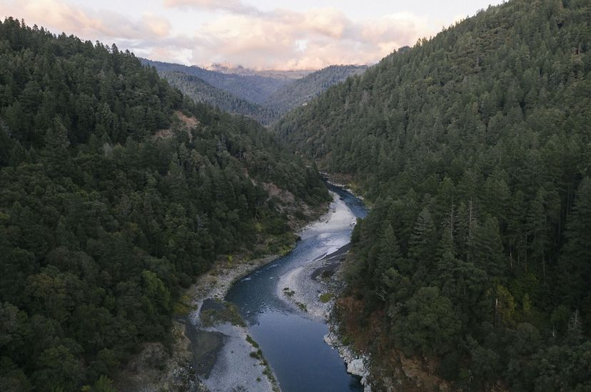 Aerial view of the Klamath River, surrounded by forested land.