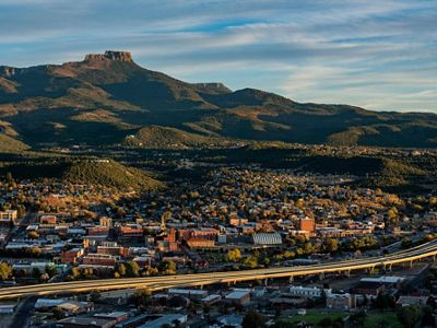 An aerial of Trinidad, Colorado with Fishers Peak in the background.