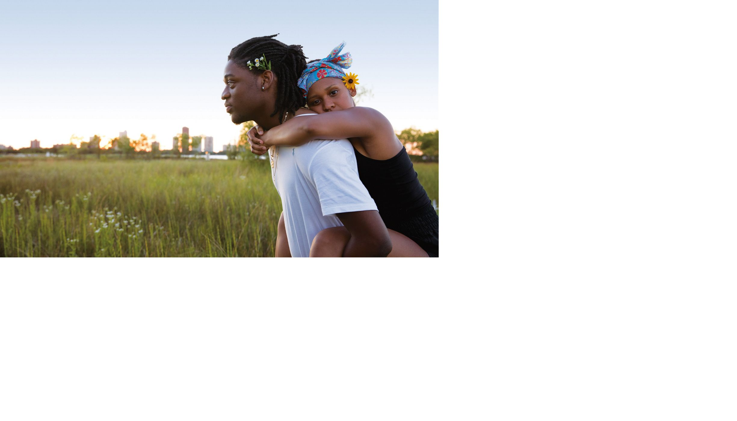 Veasna Johnson and Anthony Okocha celebrate the first day of summer with a picnic at Chicago's Montrose Beach Dunes, Illinois.