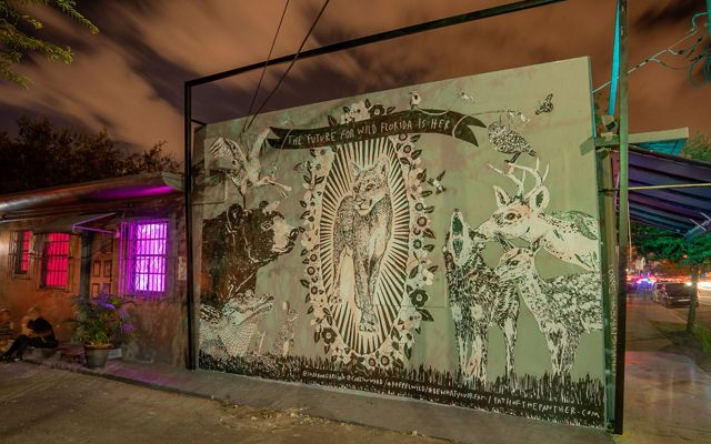 a mural shows a panther and other wildlife
