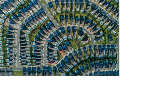 aerial of cookie cutter housing development with pools and small yards in sprawling surburbia of orlando florida