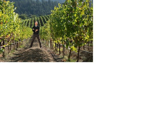 California vintner Garnaud Weyrich stands between rows of grapes at his vineyard