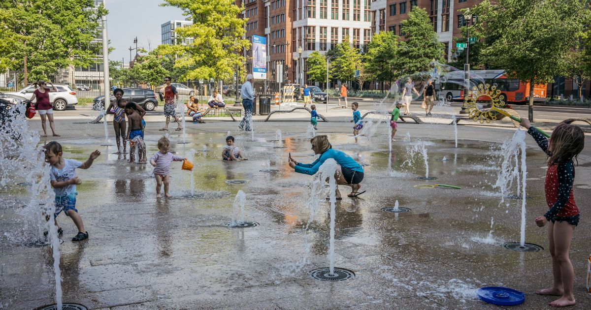 Children play on a splash pad in Washington, DC.
