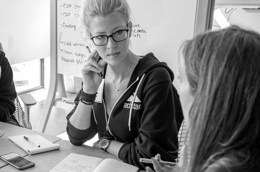 Erin Rothman sits and listens to another Techstars participant