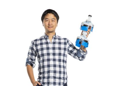 You Wu, cofounder of Watchtower Robotics, holds up a pipe-mapping robot in his left hand
