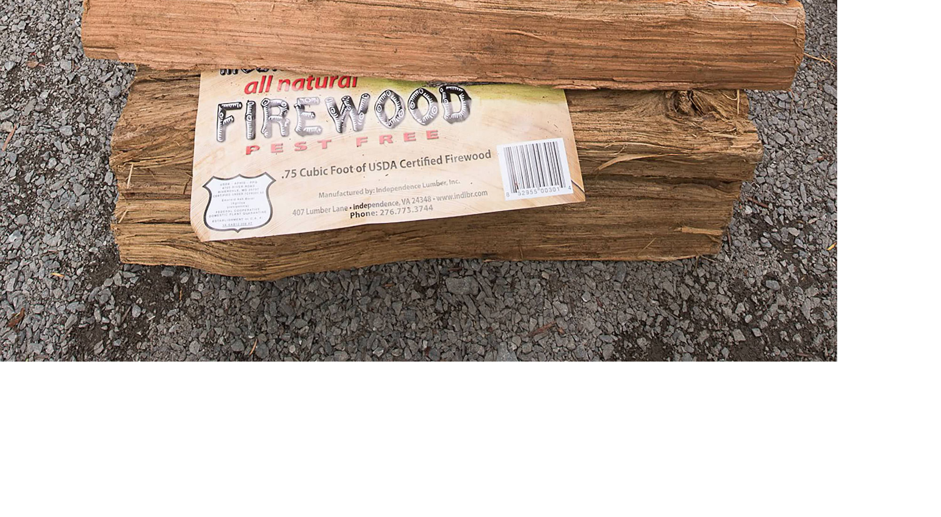 A pile of heat-treated firewood awaits purchase.