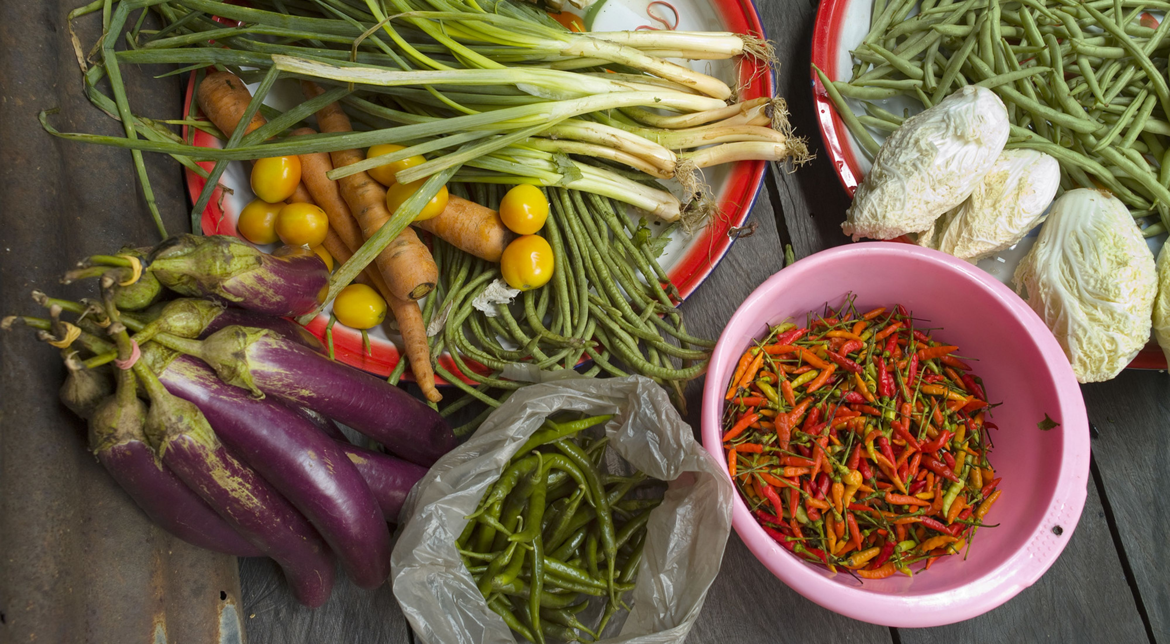 Locally grown and collected vegetables sorted for cooking at Long Laay (Long Laai) village which is situated on the banks of the Sagah River in the Bornean forest of the Berau district, East Kalimantan, Borneo, Indonesia.