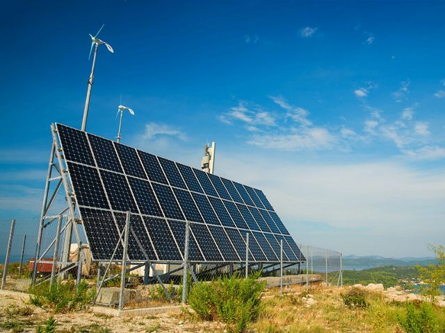 a small solar panel on top of a mountain in the Adriatic sea