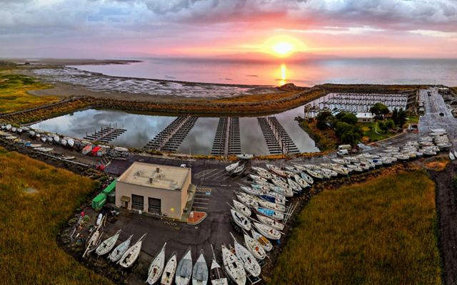 Aerial view of a marina on the Great Salt Lake at sunset.