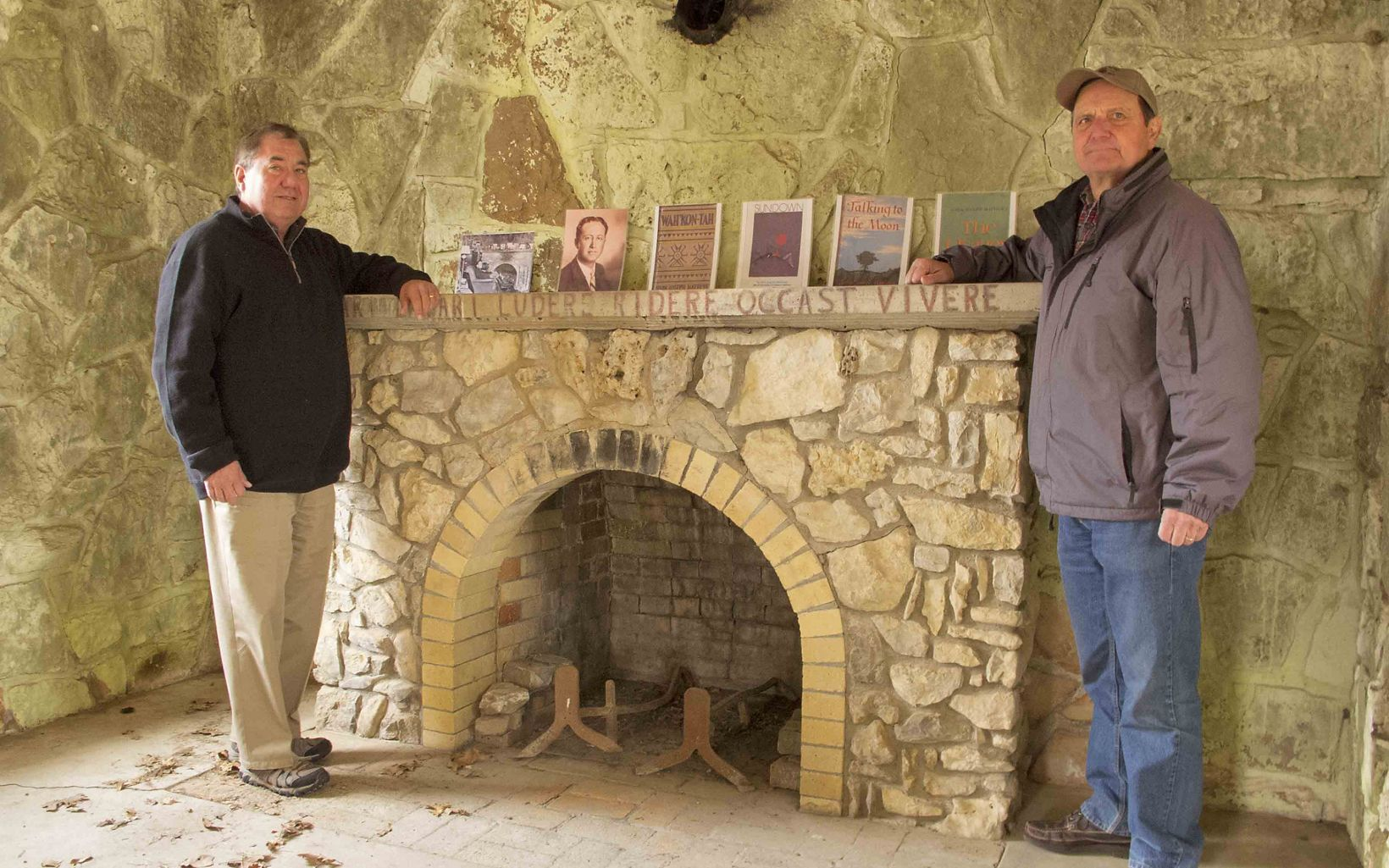 Geoffrey Standing Bear, Osage Nation Chief, stands with Harvey Payne next to the fireplace in John Joseph Mathews Cabin.