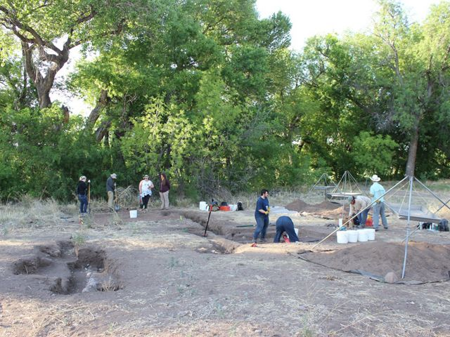 Several people on an archaelogical dig.