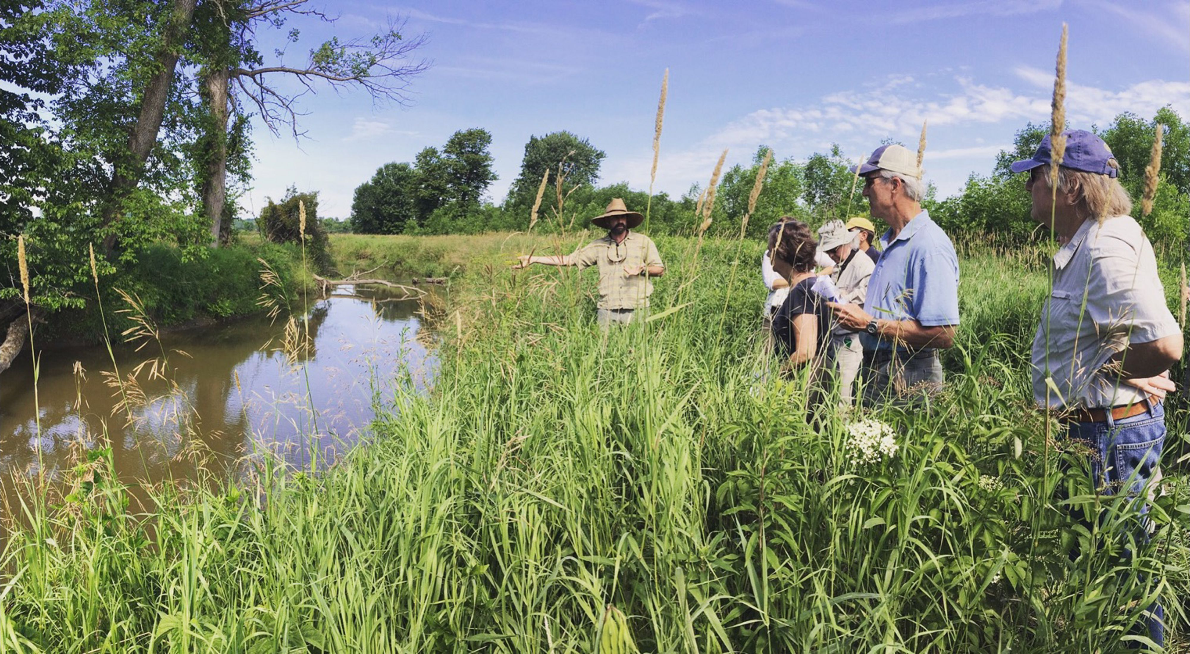 Photo of watershed Restoration Manager, Shayne Jaquith, showing partners around Goad Project.