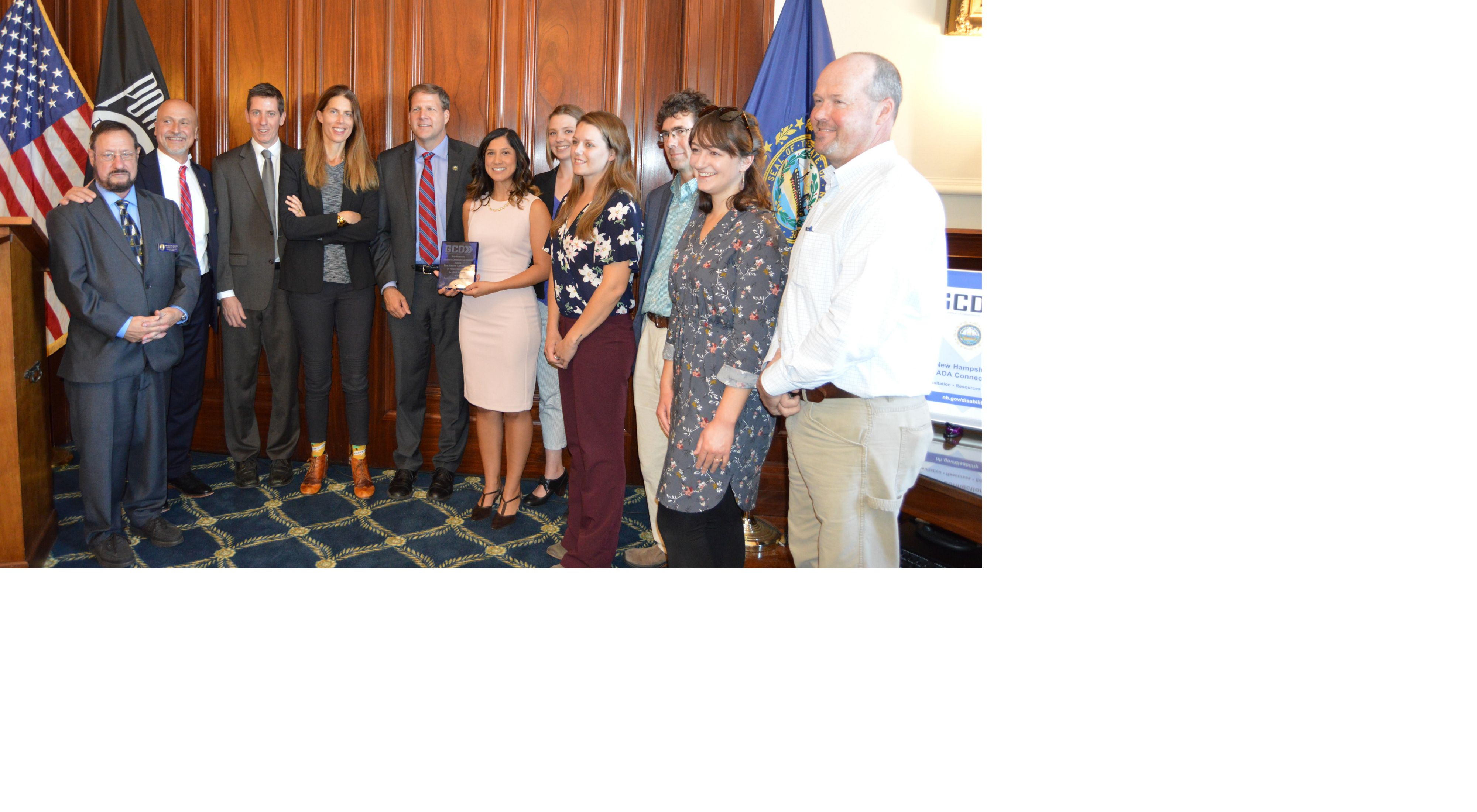 Staff from The Nature Conservancy in New Hampshire accept the 2019 Governor's Disability Award from Governor Chris Sununu.