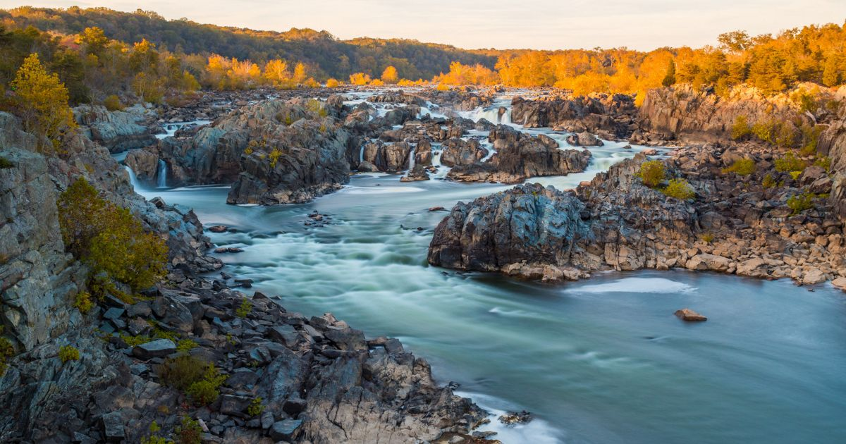 At Great Falls, the Potomac River builds up speed and force as it falls over a series of steep, jagged rocks and flows through the narrow Mather Gorge.