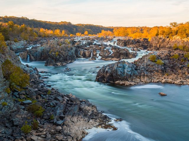 The Potomac River falls over the rocky outcrops at Great Falls before smoothly flowing into the channel.