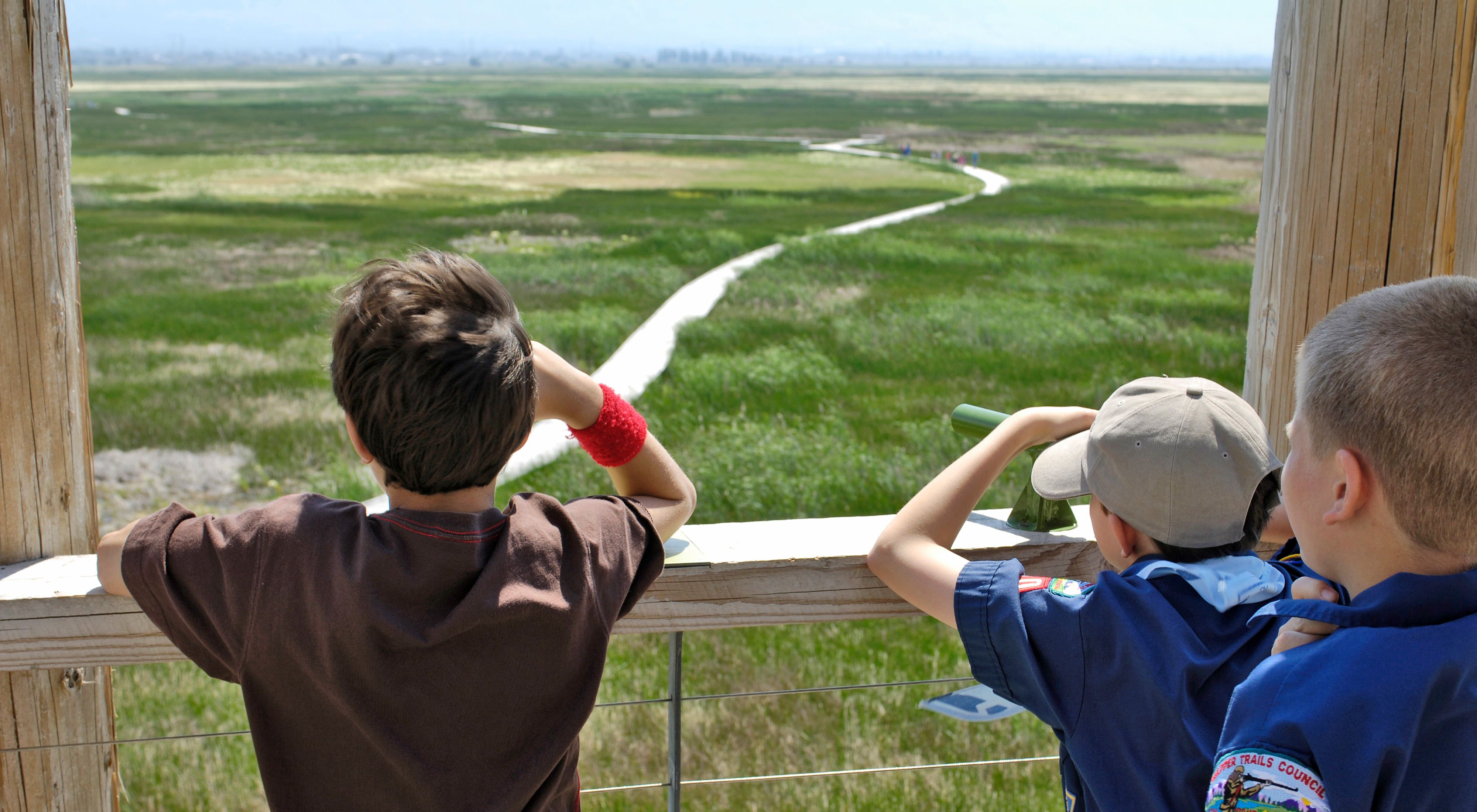 Children look our over the Great Salt Lake Shorelands Preserve