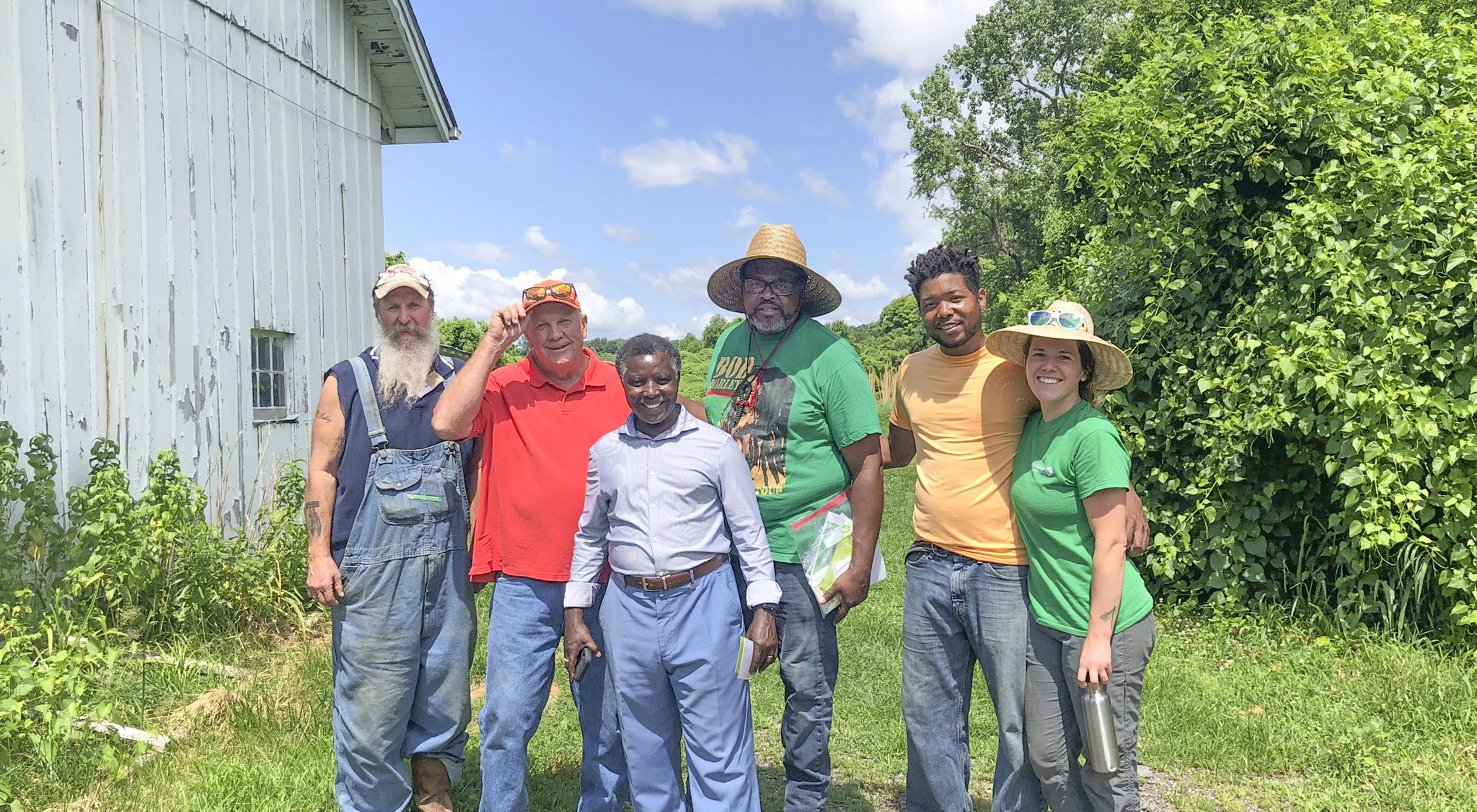 Pastor Bruce Carroll of Green The Church visits with Rebecca Weaver, Pastor Paul and Gibron Jones at Confluence Farms in St. Louis, MO.