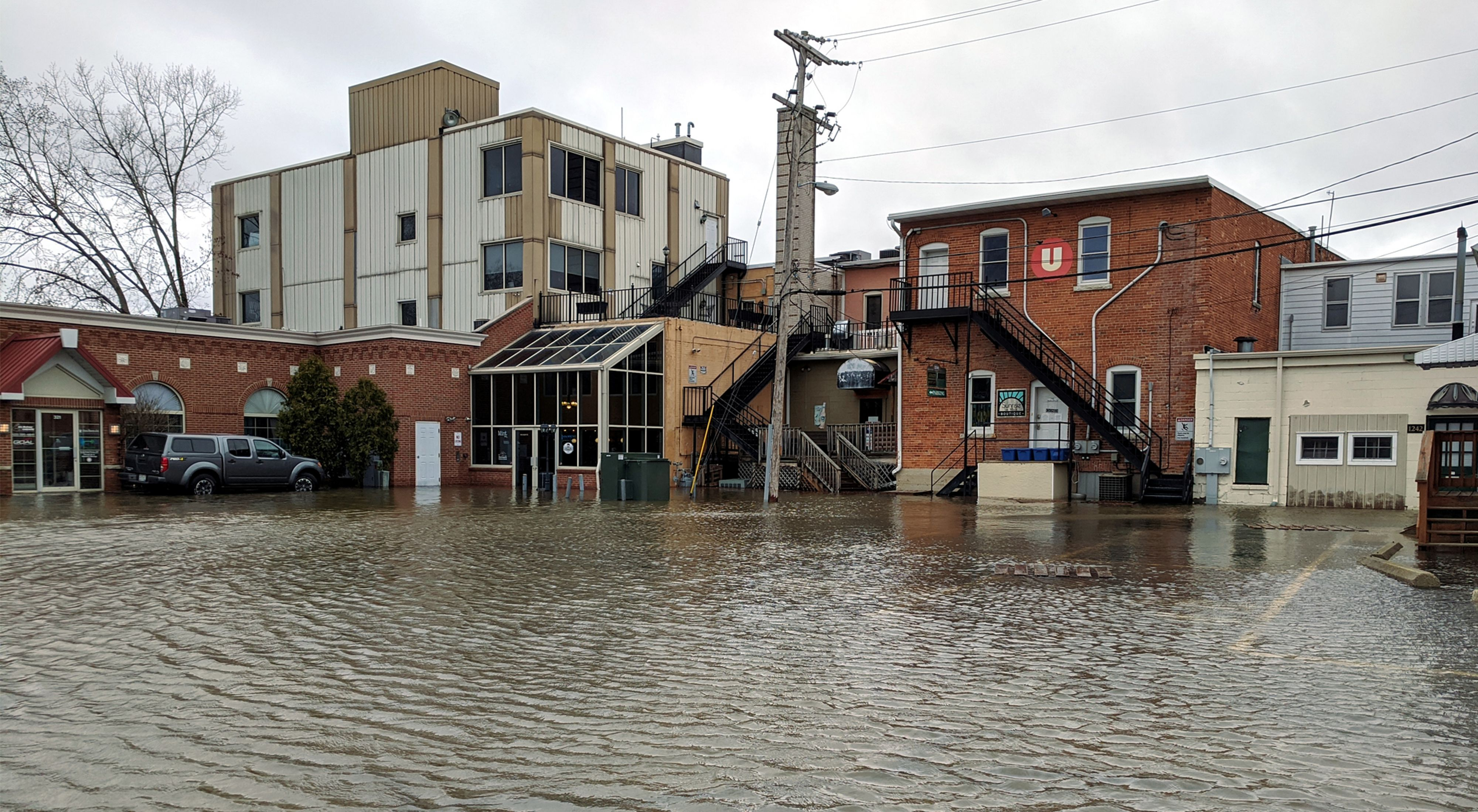 Several buildings in Green Bay, Wisconsin with floodwaters coming up to the entrances.
