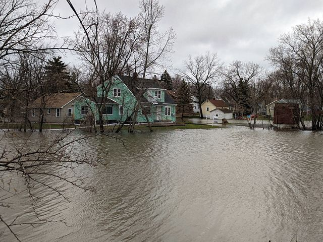 Homes are flooded on a rainy day in Green Bay, Wisconsin.