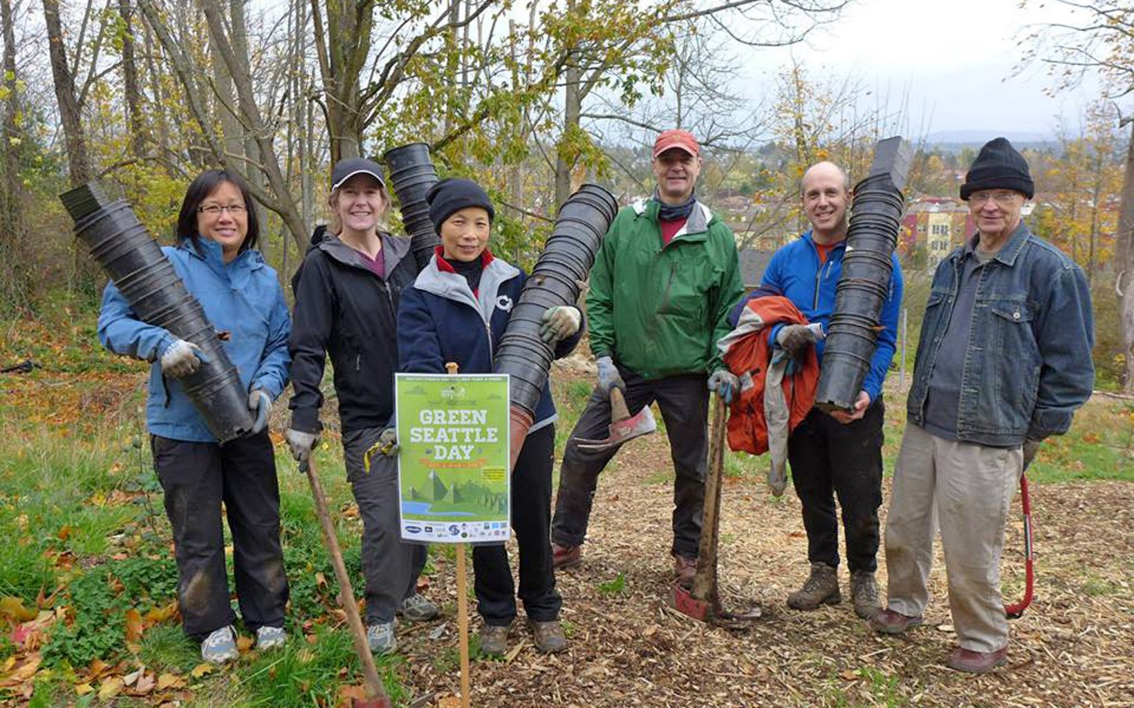 Volunteers in Seattle, WA plant trees as part of Green Seattle Day, 2013.