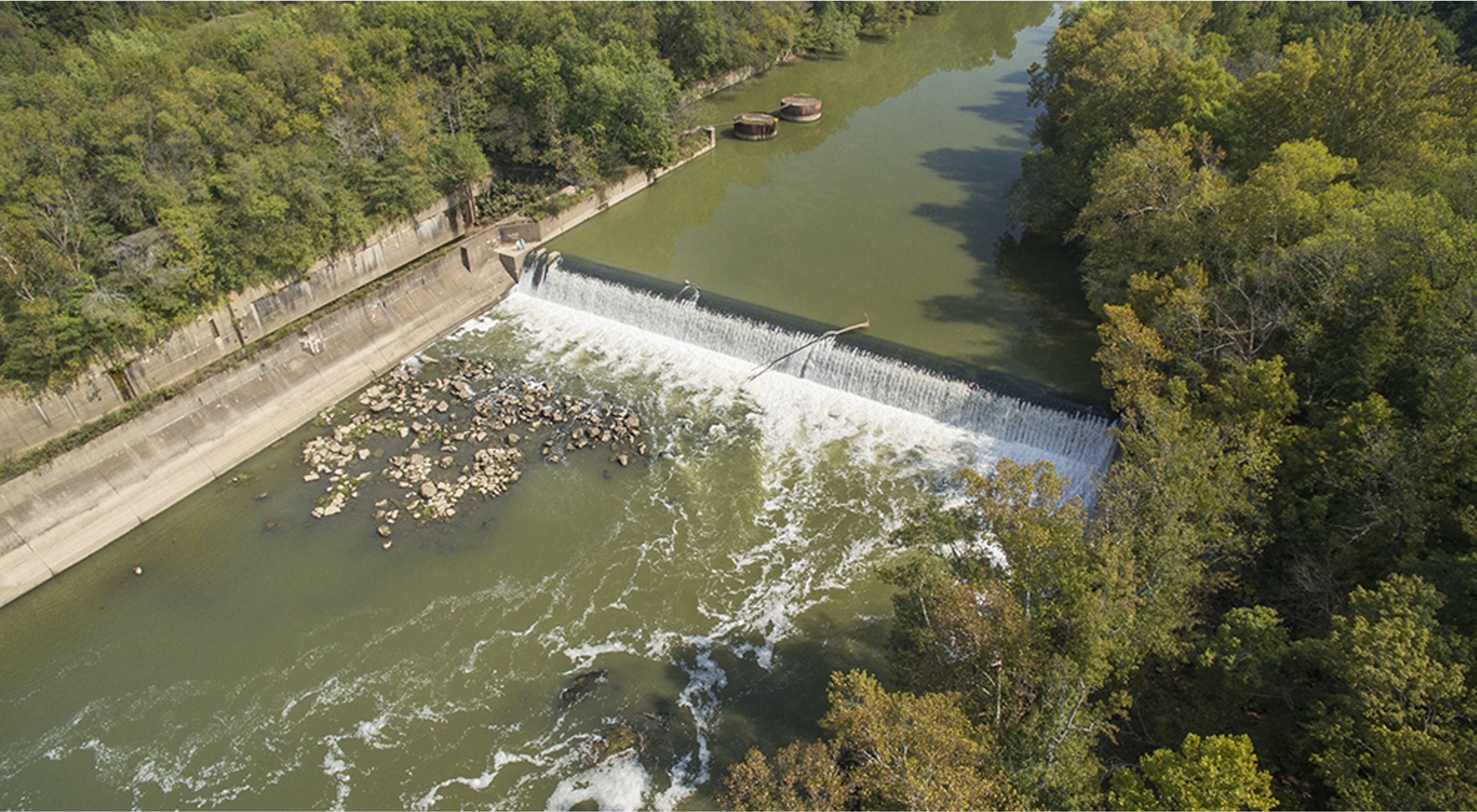 Aerial view of a large dam in the middle of a river.