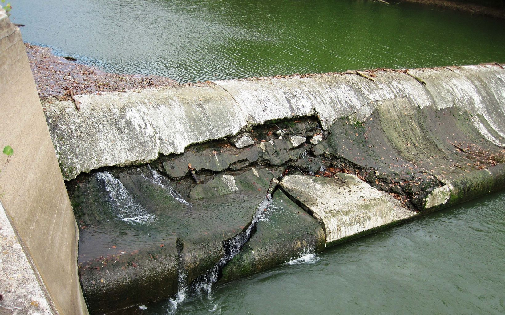 An aging dam starts to show signs of stress.