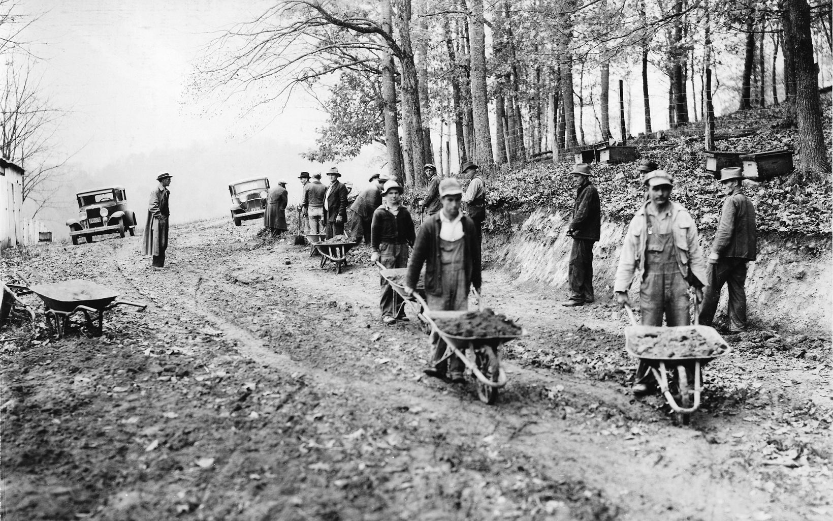 An historic image of workers building infrastructure needed for a dam.